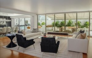Large drawing room with couches and aluminium doors windows